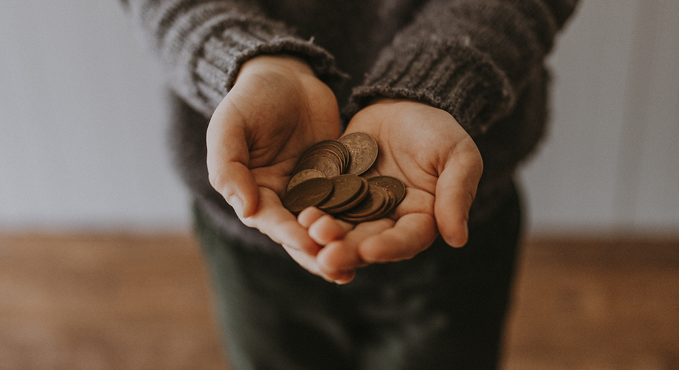 Person holding out pennies in their hands