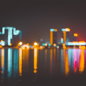 City lights reflecting onto water.