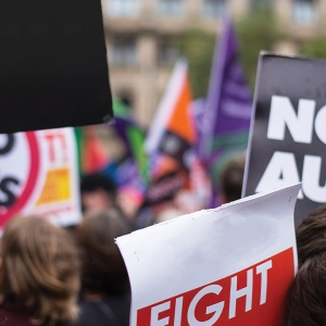 Protest signs saying 'no more austerity'