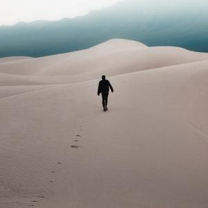 Man walking through a desert