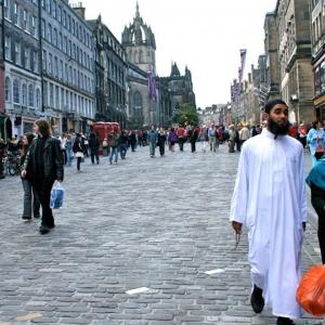 Muslim family walking down a street.