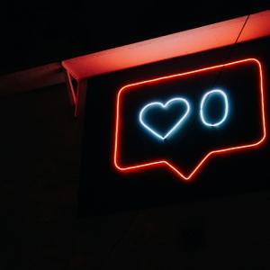 Neon speech bubble with a heart in it