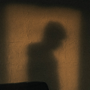 Shadow of a person in a doorway.