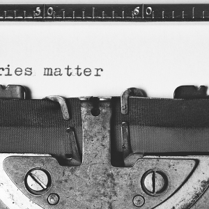 Typewriter and the words 'Stories matter'