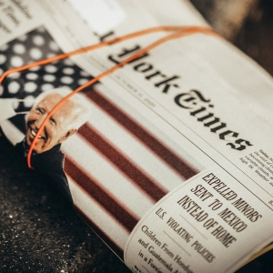 Newspaper rolled up with Biden on it.