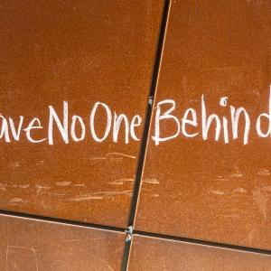 Writing on floor saying #LeaveNoOneBehind